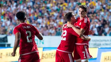 Kenny McLean (right) celebrates pulling a goal back for Aberdeen against Kairat.