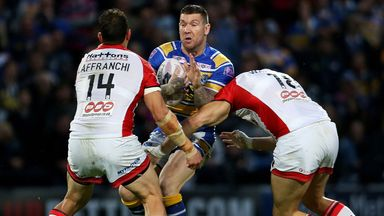 St Helen's Anthony Laffranchi and Alex Walmsley (right) tackle Leeds Rhinos' Brett Delaney