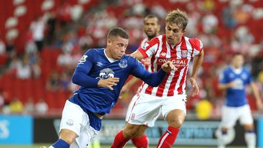 Marc Muniesa (right) puts Ross Barkley under pressure