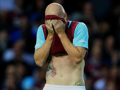 West Ham's James Collins leaves the field dejected after being shown a red card