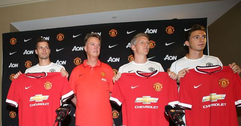 Louis van Gaal: Poses with three of Manchester United's summer signings