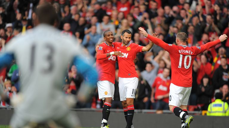 Ashley Young, Ryan Giggs and Wayne Rooney celebrate during Manchester United's 8-2 win over Arsenal in 2-11