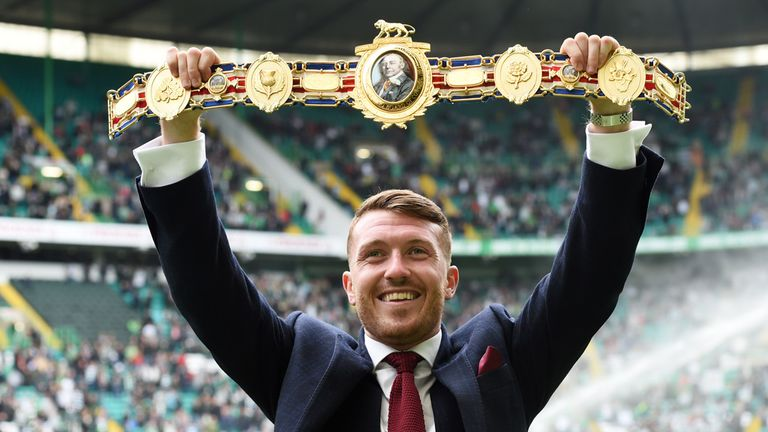 Scott Cardle shows off his British lightweight title to the Celtic fans