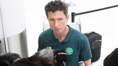 John Collins addressing the media at Glasgow Airport ahead of flight to Baku