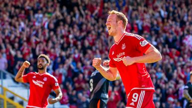 Adam Rooney wheels away to celebrate his penalty for Aberdeen against Kilmarnock.