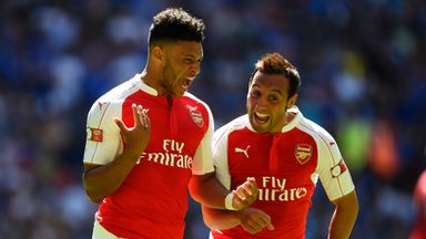 Alex Oxlade-Chamberlain (L) celebrates opening the scoring.