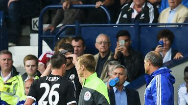 Jose Mourinho looks on as John Terry trudges off at The Hawthorns