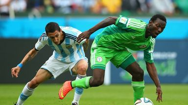 Juwon Oshaniwa (right), pictured in action for Nigeria against Angel Di Maria of Argentina, has signed for Hearts.