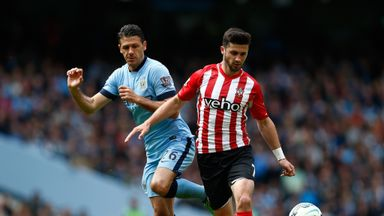 Shane Long of Southampton and Martin Demichelis of Manchester City could go head-to-head again this weekend
