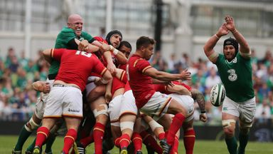 Paul O'Connell (left) watches on as Sean O'Brien attempts to block down Rhys Webb's box kick