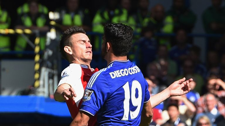 Diego Costa clashes with Laurent Koscielny during Chelsea's 2-0 victory