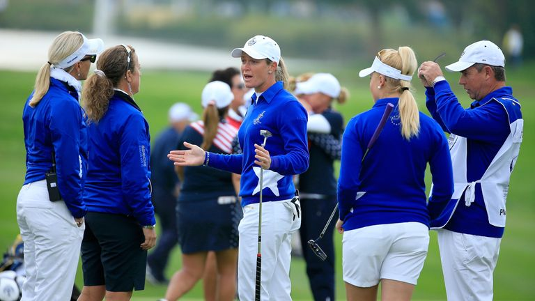 Suzann Pettersen (middle) talks to other members of the Europe team