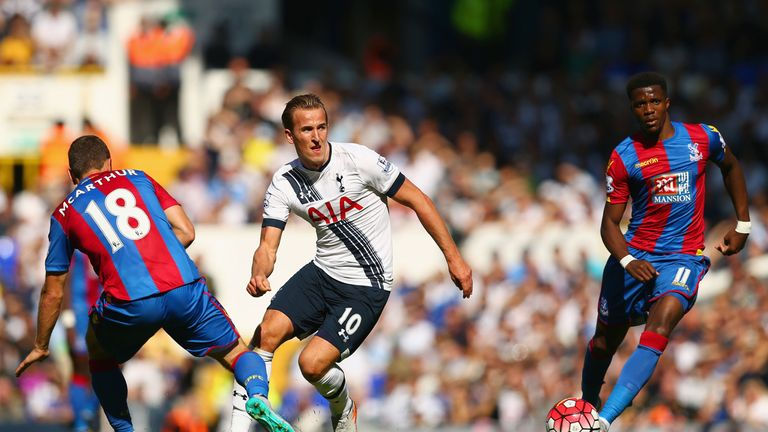 Tottenham's Harry Kane takes on James McArthur and Wilfried Zaha