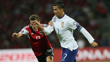 Cristiano Ronaldo (R) will be hoping to inspire Portugal to victory over Denmark