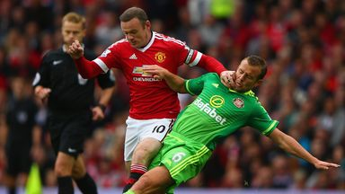 Lee Cattermole slides in on Wayne Rooney
