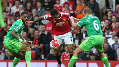Memphis Depay (left) in action with Lee Cattermole