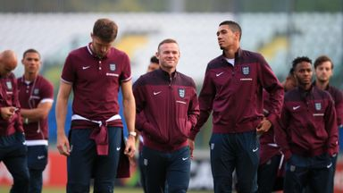 Wayne Rooney (middle) takes a stroll with his England team-mates at the San Marino stadium on Friday evening