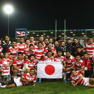 Japan pose for a team photograph after their win over the USA