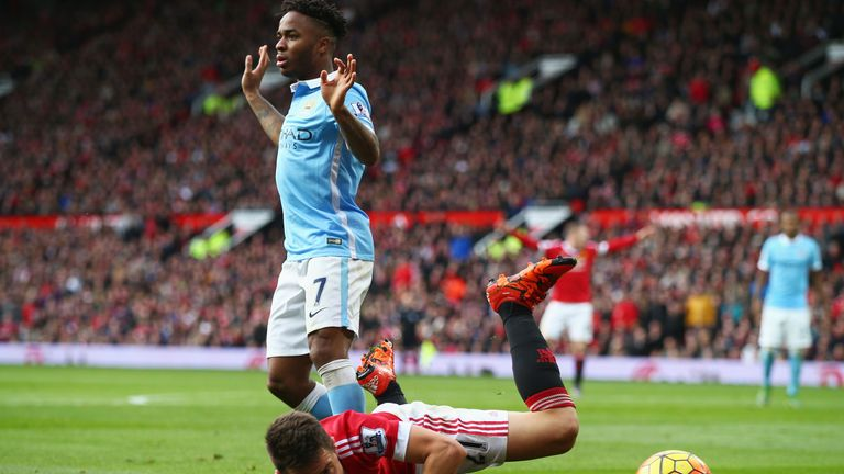 Ander Herrera falls under Raheem Sterling's challenge in Manchester derby at Old Trafford
