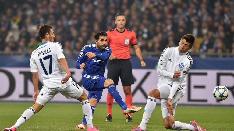 Cesc Fabregas (middle) hits a shot in the second half, after being denied a penalty early in the match
