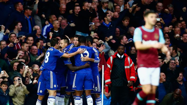 Gary Cahill celebrates with Chelsea team-mates after his equaliser