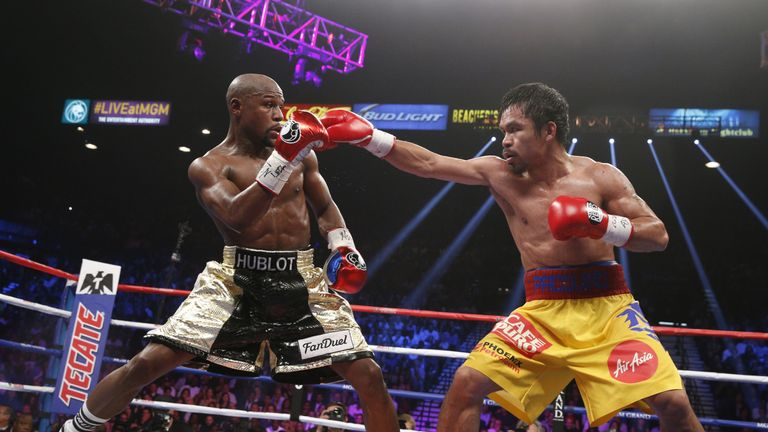 Manny Pacquiao (right) says he is in talks over a rematch with Floyd Mayweather