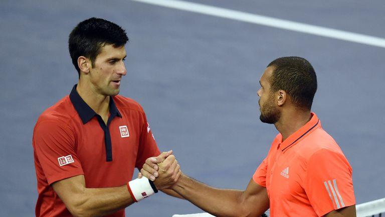Djokovic shakes hands with Jo-Wilfried Tsonga (right) at the end of the match