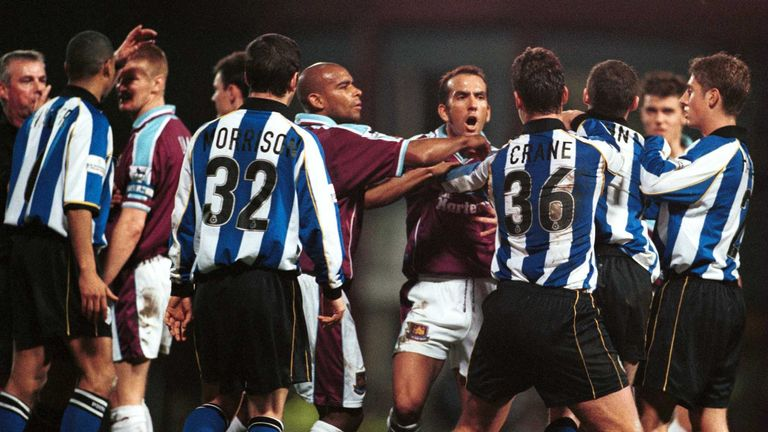 Di Canio shows his aggressive side during a game with Sheffield Wednesday
