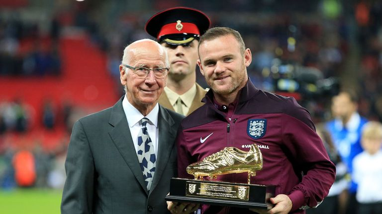 Sir Bobby Charlton presents England's Wayne Rooney with a golden boot after the striker broke his record