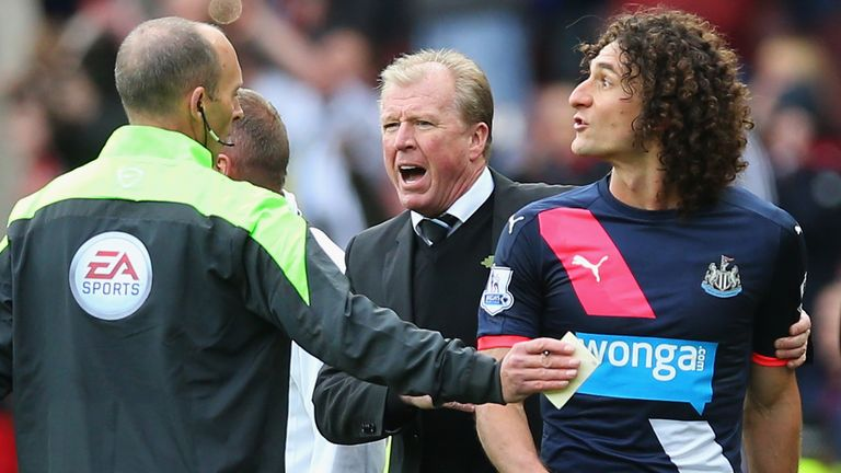 Fabricio Coloccini of Newcastle leaves the pitch after being sent off while Steve McClaren looks on