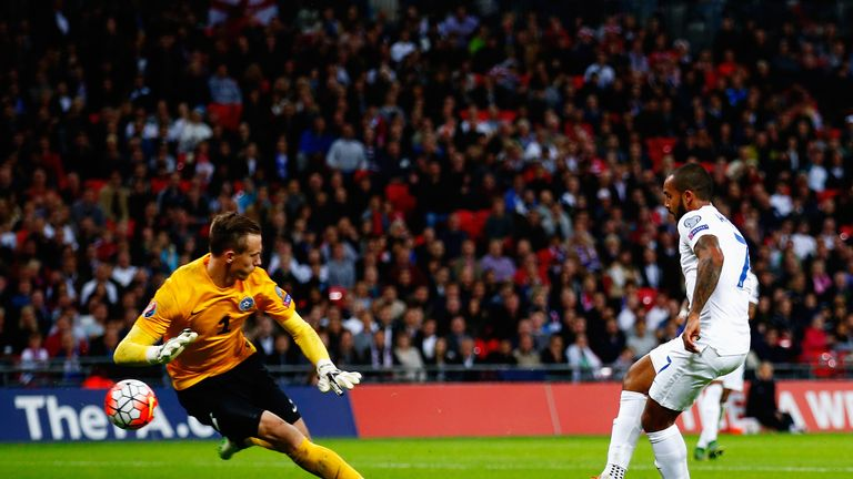 Theo Walcott opens the scoring for England on the stroke of half-time
