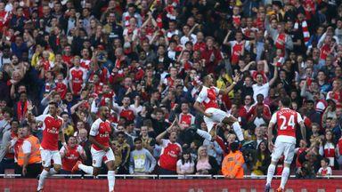 Arsenal's Alexis Sanchez (second right) celebrates scoring Arsenal's third - a thunderous strike into the top-right corner