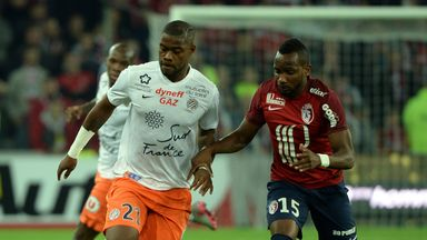 Lille's French forward  Lenny Nangis (R) vies with Montpellier's French defender William Remy.
