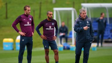 Harry Kane (left) or Theo Walcott (middle) could start up front in Rooney's absence