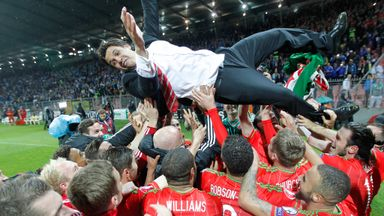 Wales players carry Chris Coleman aloft after securing qualification to Euro 2016