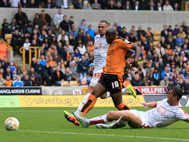 Benik Afobe scores his side's second goal of the game
