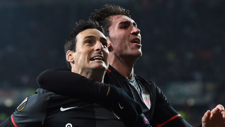 Bilbao's striker Aritz Aduriz (left) and Bilbao's French defender Aymeric Laporte (right) celebrate scoring during the