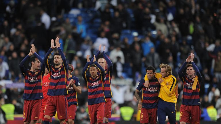 Barcelona players celebrate after the win at the Bernabeu