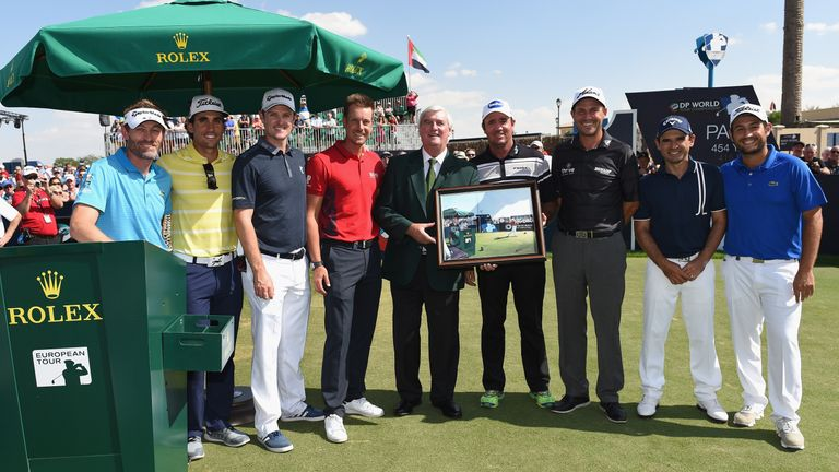 On the tee: Ivor Robson (centre) with a number of players who presented him with a painting following a 40-year career as the European Tour's official starter