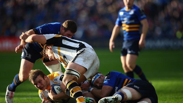 Joe Launchbury is tackled by Jamie Heaslip