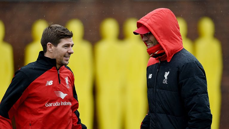 Gerrard talks to Jurgen Klopp during a training session at Melwood