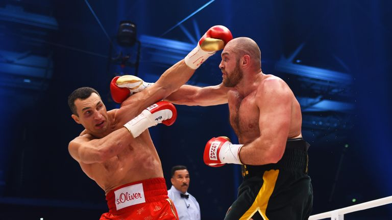 Tyson Fury (left) used his length against Wladimir Klitschko