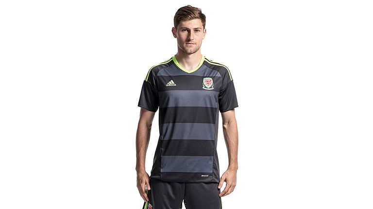 Wales may also wear a two-tone black shirt, which features electric green detailing