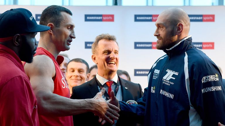 Fury and Wladimir Klitschko's fight will go ahead after a row over the ring