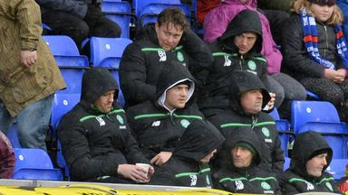 Anthony Stokes  (middle row, centre) takes his seat in the main stand in Inverness