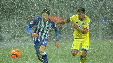 Genki Haraguchi (L) of Hertha battles for the ball with Eugen Polanski (R) of Hoffenheim during their Bundesliga match