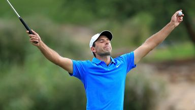 Charl Schwartzel celebrates after holing out on the final green