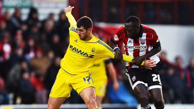 Nelson Oliveira (left) holds off Toumani Diagouraga (right) as the Frenchman makes his 200th league appearance