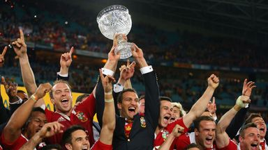 Injured captain Sam Warburton and Lions captain Alun Wyn Jones hold the Tom Richards Cup aloft after the 2013 series victory in Australia