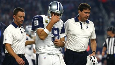 Tony Romo #9 of the Dallas Cowboys is lead to the sidelines following his injury